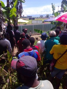 Tickets sold out and forced these people to stand outside find every space to watce the 6th PNG Games in Lae